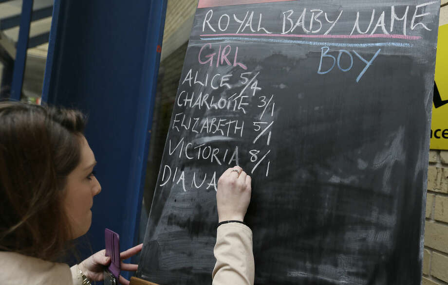 Betting odds are written on a chalkboard outside the Lindo Wing at St. Mary's Hospital in anticipation of Kate, Duchess Cambridge giving birth to her second child, London, Saturday, May 2, 2015. Prince William's wife Kate entered a London hospital Saturday to give birth to their second child, igniting a national wave of anticipation and a last-minute betting spree on the name of the new prince or princess. (AP Photo/Tim Ireland)