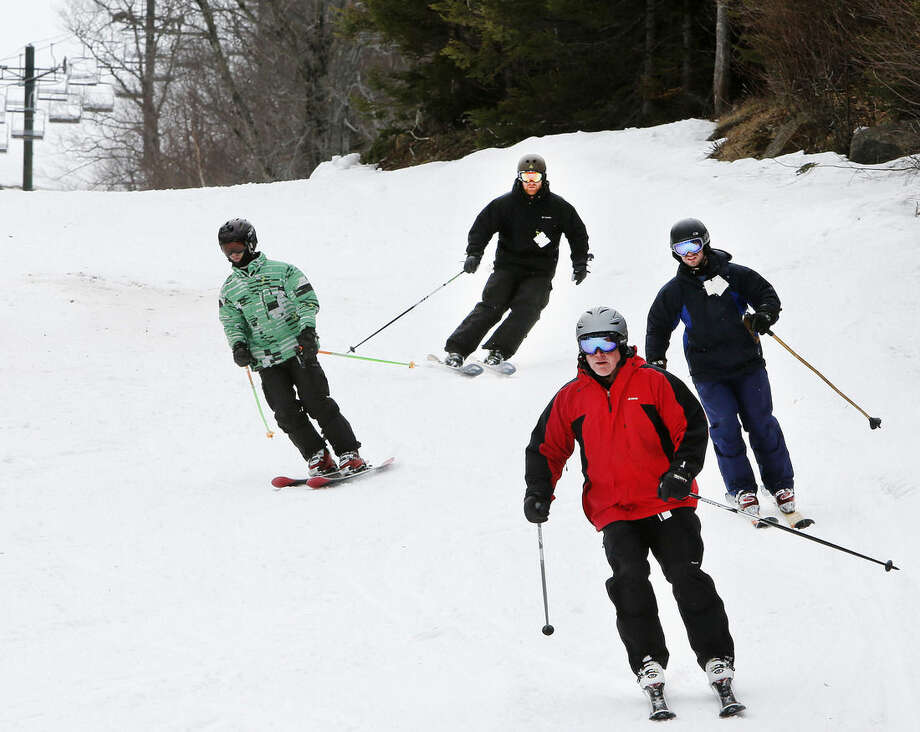 In this photo taken Saturday April 25, 2015 a skiers are skiing the tjrails at Wildcat ski area in Gorham, N.H. The ski season has stretched longer into spring than it has in recent years, due to a deep base of snow and unseasonably cold spring. (AP Photo/Jim Cole)