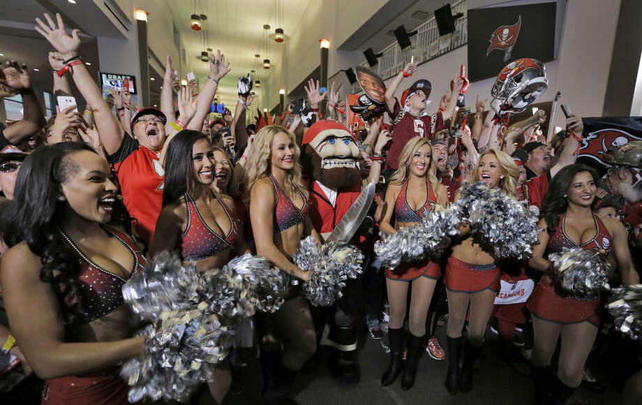 The Tampa Bay Buccaneers cheerleaders celebrate along with fans after the team drafted former Florida State quarterback Jameis Winston during an NFL draft party Thursday, April 30, 2015, in Tampa, Fla. Winston was the first overall pick in the draft. (AP Photo/Chris O'Meara)