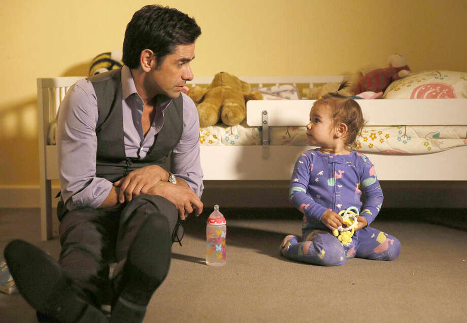 "This image released by Fox shows John Stamos in a scene from ""Grandfathered,"" a comedy premiering on Fox next season. (Jennifer Clasen/FOX via AP)"