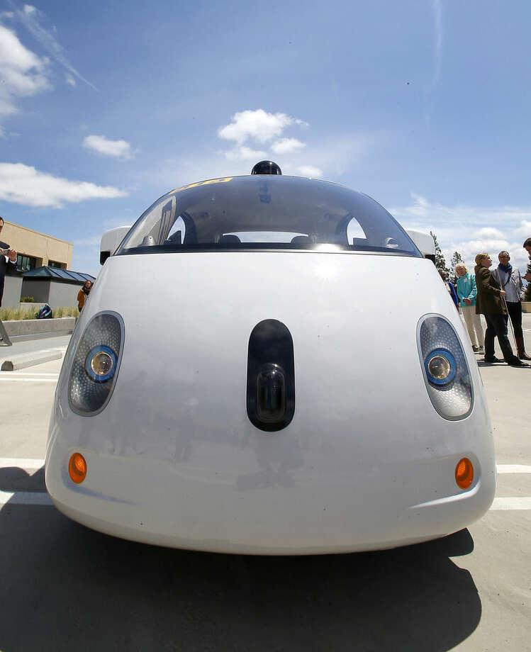 This May 13, 2015 photo shows the front of Google's new self-driving prototype car during a demonstration at Google campus in Mountain View, Calif. The car, which needs no gas pedal or steering wheel, will make its debut on public roads this summer. (AP Photo/Tony Avelar)