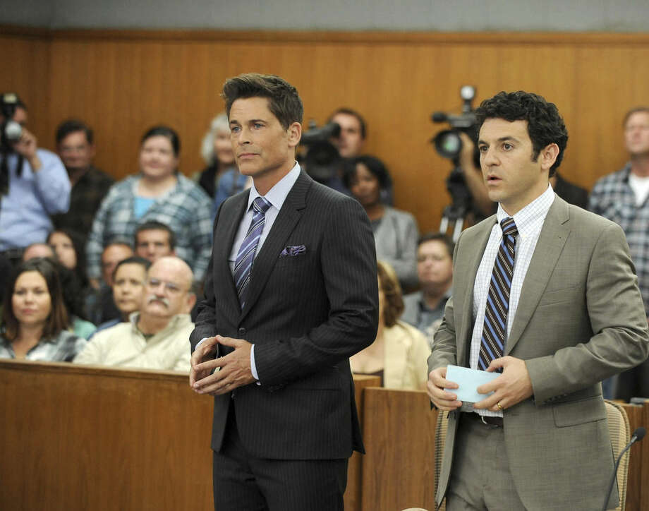"""This image released by Fox shows Rob Lowe, left, and Fred Savage in a scene from """"The Grinder,"""" a new series in the Fox new season line-up. (Ray Mickshaw/FOX via AP)"""