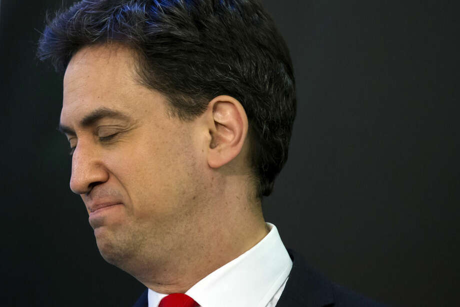 Labour Party leader Ed Miliband waits to speak after holding his seat as results are announced in Britain's general election, in Doncaster, England, Friday May 8, 2015. The Conservative Party fared much better than expected in Britain's parliamentary election, with an exit poll and early returns suggesting that Prime Minister David Cameron would remain in his office at 10 Downing Street. The opposition Labour Party took a beating, according to the exit poll, much of it due to the rise of the separatist Scottish National Party. (AP Photo/Jon Super)