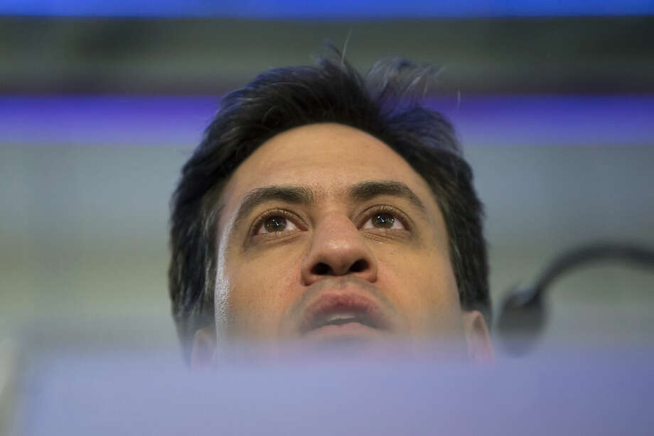 Labour Party leader Ed Miliband speaks after holding his seat at Doncaster Racecourse as results come in after voting closes in Britain's general election, in Doncaster, England, Friday May 8, 2015. The Conservative Party fared much better than expected in Britain's parliamentary election, with an exit poll and early returns suggesting that Prime Minister David Cameron would remain in his office at 10 Downing Street. The opposition Labour Party took a beating, according to the exit poll, much of it due to the rise of the separatist Scottish National Party. (AP Photo/Jon Super)