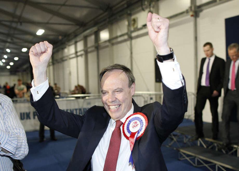 Democratic Unionist Party candidate for North Belfast Nigel Dodds celebrates after being elected MP for North Belfast at the Kings Hall count center, in Belfast, Northern Ireland, Friday, May 8, 2015. The Conservative Party fared much better than expected in British parliamentary elections Thursday, an exit poll projected, suggesting that Prime Minister David Cameron is within touching distance of forming a new government. Cameron could also seek support from the right-of-center Democratic Unionists in Northern Ireland, who had eight seats before the election, or the anti-European, anti-immigration U.K. Independence Party. (AP Photo/Peter Morrison)