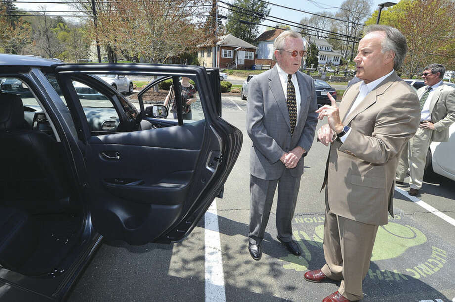 Hour Photo/Alex von Kleydorff Wilton First selectman Bill Brennan talks about the 2015 Nissan Leaf EV and the new quick charge station with Bruce Bennett at Bruce Bennett Nissan in Wilton