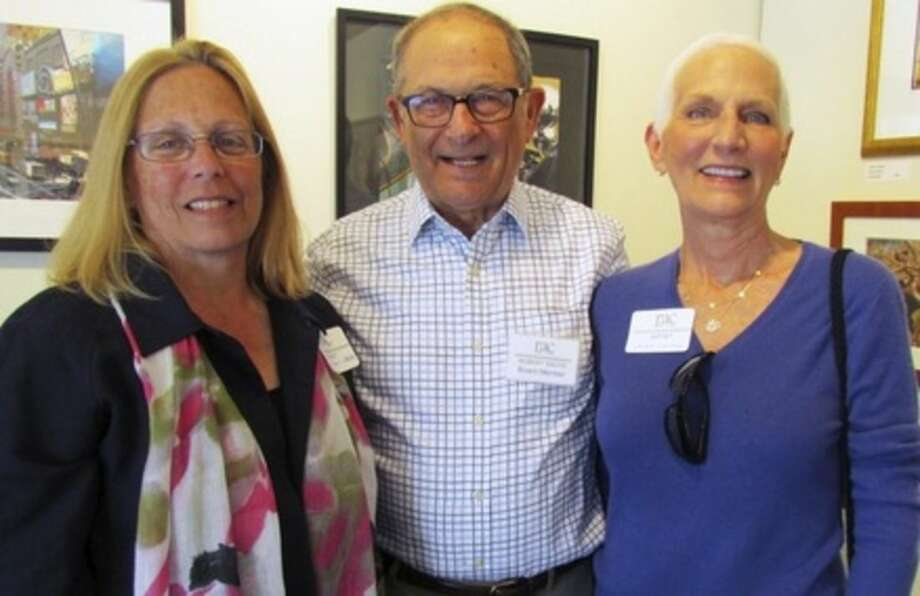 """Contributed photoBest in Show award winner, Laure Dunne (right) is joined by Pamela Riley Abear, and Robert Sachs during the opening reception for the """"Photography & Sculpture"""" exhibition at the Rowayton Arts Center."""