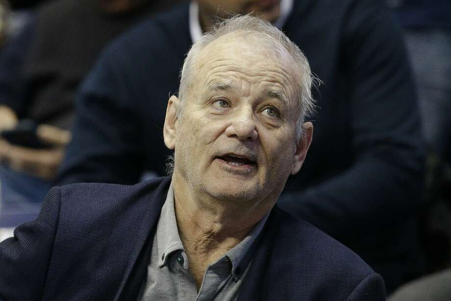FILE - In this Feb. 24, 2016 file photo, actor Bill Murray attends an NCAA college basketball game between Xavier and Villanova in Cincinnati. Despite his move into serious roles, Bill Murray never stopped making people laugh. Now he's being honored with the nation's top prize for comedy. The John F. Kennedy Center for the Performing Arts announced Monday, June 13, 2016, that Murray will be this year's recipient of the Mark Twain Prize for American Humor. (AP Photo/John Minchillo) Photo: John Minchillo, Associated Press