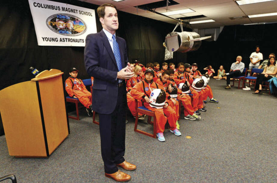 Hour photo / Erik Trautmann US Congressman Jim Himes congratulates the participants as the Young Astronauts program at Columbus Magnet School celebrates the landing of their latest mission, Infinite Vision, and the programs 20th anniversay Friday morning at the school.
