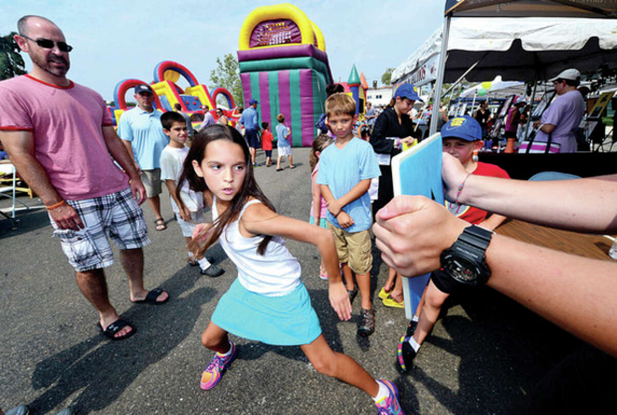 Izabella Lopez-Kalapir tries out her karate at Kempo Academy during Westport's 5th annual Blues Views and BBQ at Jesup Green Saturday. Hour photo / Erik Trautmann