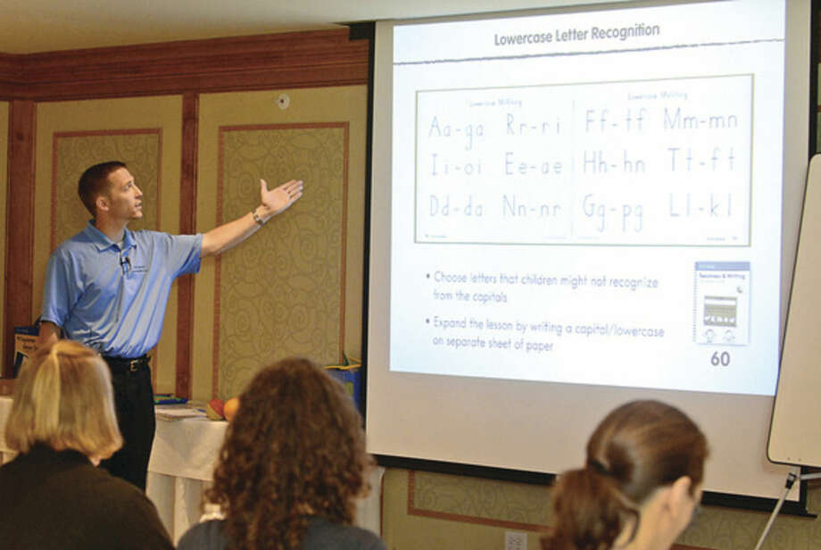 Hour photo / Erik Trautmann Handwriting Without Tears Workshop presenter, Keith R. Kline, discusses how cursive education has differed drastically from how the skill was taught in the past, and its overall importance as a valuable life skills during a workshop at The Norwalk Inn Friday.