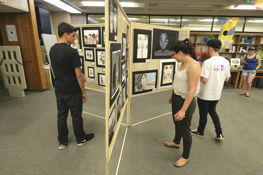 Hour Photo/Alex von Kleydorff Students view the art show in the library at Norwalk High School