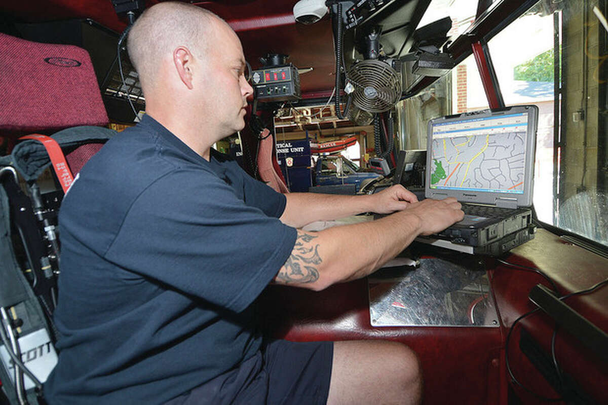 Wilton Firefighter Mike Pryor pulls up the location of town vehicles on one of the Fire Trucks Mobile Data Terminal.