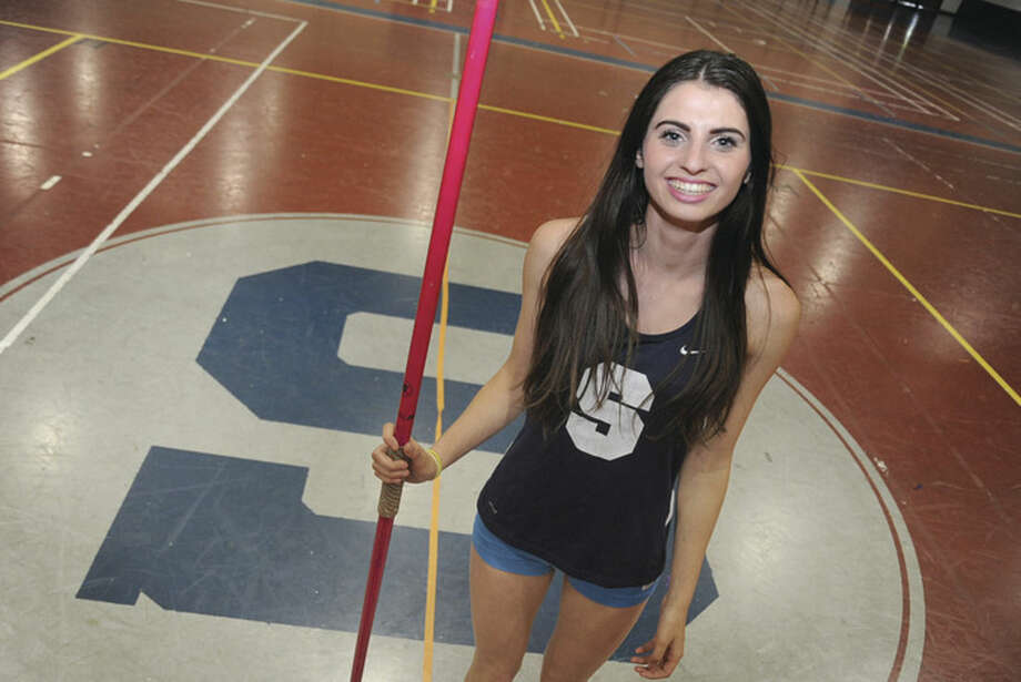Hour photo/Matthew VinciOlivia Wiener of Staples High School stands 5-foot-3 and weighs just over 100 pounds, but she's the defending state Class LL javelin champion eyeing the FCIAC title on Tuesday at Danbury High School.
