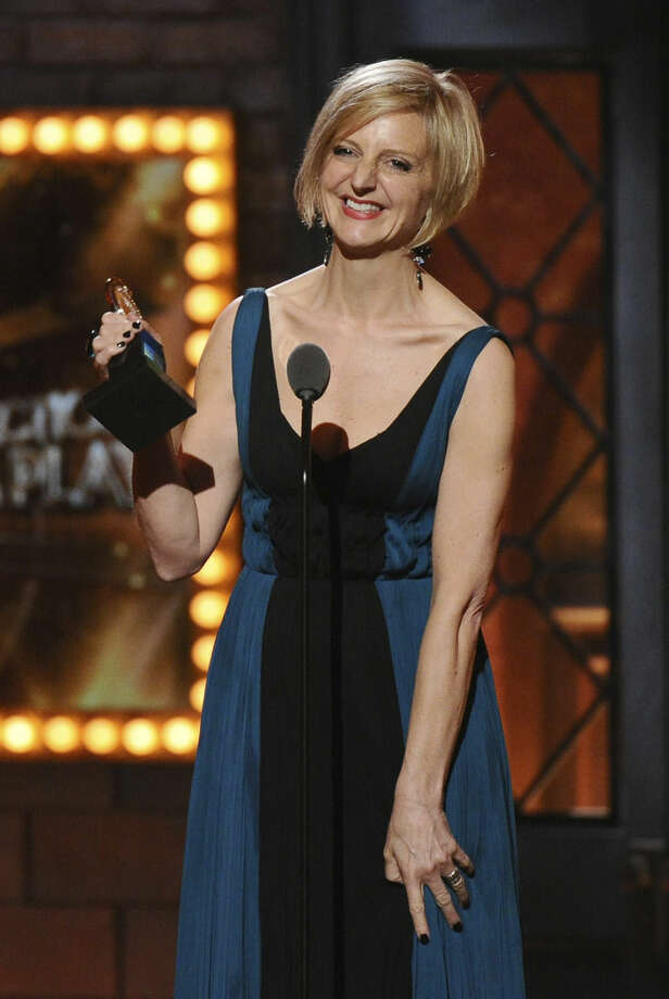 """Marianne Elliott accepts the award for best direction of a play for """"The Curious Incident of the Dogg in the Night-Time"""" at the 69th annual Tony Awards at Radio City Music Hall on Sunday, June 7, 2015, in New York. (Photo by Charles Sykes/Invision/AP)"""