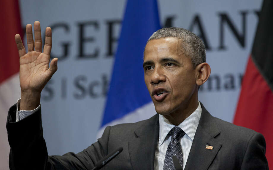U.S. President Barack Obama waves as he finished speaking during a news conference at the G-7 summit in Schloss Elmau hotel near Garmisch-Partenkirchen, southern Germany, Monday, June 8, 2015. (AP Photo/Carolyn Kaster)