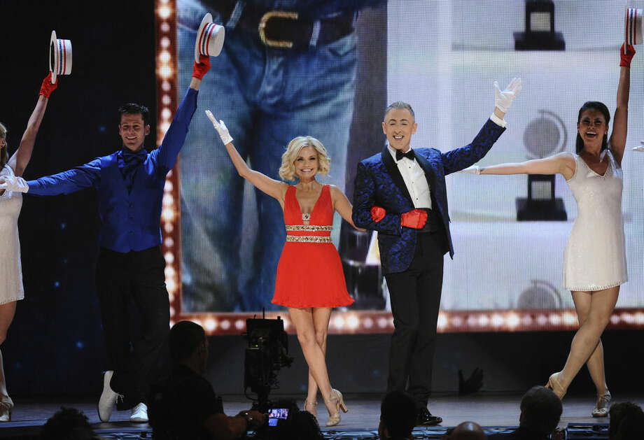 Alan Cumming, Kristin Chenoweth and dancers perform a tribute to Tommy Tune, winner of the lifetime achievement award at the 69th annual Tony Awards at Radio City Music Hall on Sunday, June 7, 2015, in New York. (Photo by Charles Sykes/Invision/AP)