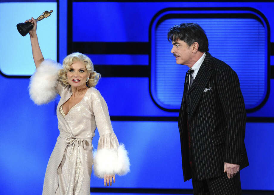 "Kristin Chenoweth, left, and Peter Gallagher perform a number from ""On the Twentieth Century""at the 69th annual Tony Awards at Radio City Music Hall on Sunday, June 7, 2015, in New York. (Photo by Charles Sykes/Invision/AP)"