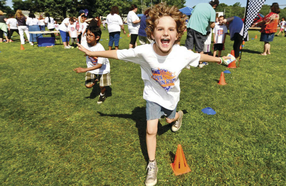 Hour photo / Erik Trautmann Fox Run Elementary School students including 3rd grader Alec Royster participate in their first ever Apex Fun Run benefit Wednesday in lieu of their annual walk-a-thon. The fundraiser will benefit the renovations of the school library.