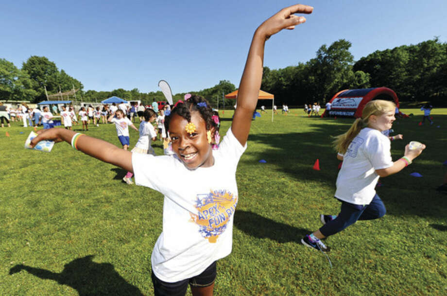 Hour photo / Erik Trautmann Fox Run Elementary School students including 3rd grader Layla Abraham participate in their first ever Apex Fun Run benefit Wednesday in lieu of their annual walk-a-thon. The fundraiser will benefit the renovations of the school library.