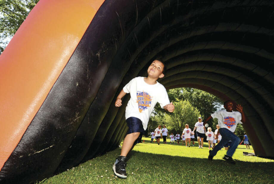 Hour photo / Erik Trautmann Fox Run Elementary School students including first grader Jonas Field participate in their first ever Apex Fun Run benefit Wednesday in lieu of their annual walk-a-thon. The fundraiser will benefit the renovations of the school library.