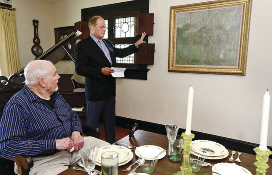 """Hour photo / Erik Trautmann Charlie Burlingham, grandson of visionary American Impressionist, Julian Alden Weirn and New Canaan resident Bill Buchanan who originally gifted the painting, """"Landscape with Steeple, Windham"""", to the Weir Farm Art Center talk about the donation of the painting to Weir Farm National Park's permanent collection during a press conference Thursday."""