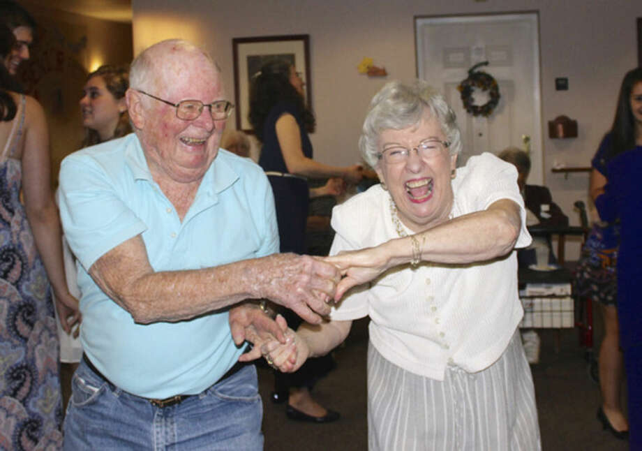 "Photo by Kim DevineResidents Bill Johnson and Mary Faith Riley dance at the Marvin's ""senior"" prom Friday."