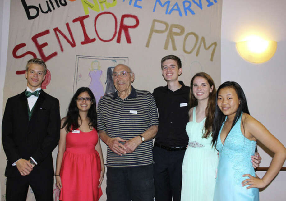 Contributed photo.From left to right: students Daniel Lott, Maria Alegria, Quinn Robinson, Kim Devine, and Olivia DiMarco with resident Joe DeRuvo.