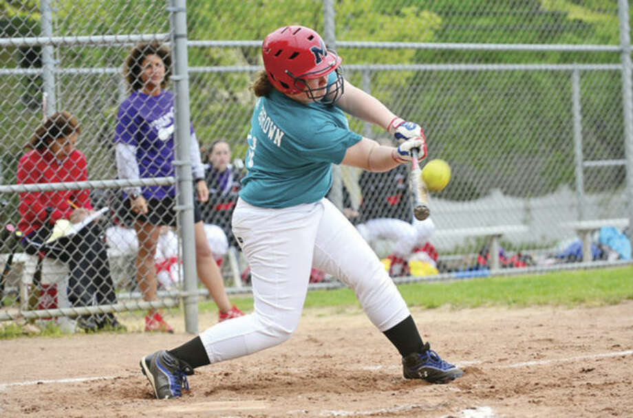 Hour photo / Erik TrautmannMcMahon's Danielle Bonis swings at a pitch during the Senators game against Greenwich Wedenesday. McMahon fell to the Cardinals 14-3 after a promising start.