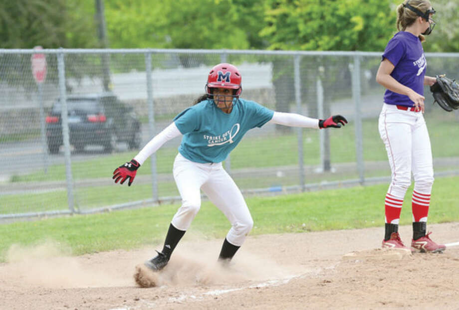 Hour photo / Erik TrautmannMcMahon softabll player Alayne Martinez rounds third to score during their game against Greenwich Wedenesday.