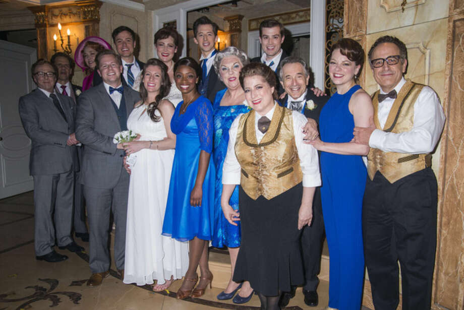 "Photo by Monica SimoesJordan Reuck and Norwalk's Matt Harter and the cast of ""It Shoulda Been You"" after the couple got married following a performance."