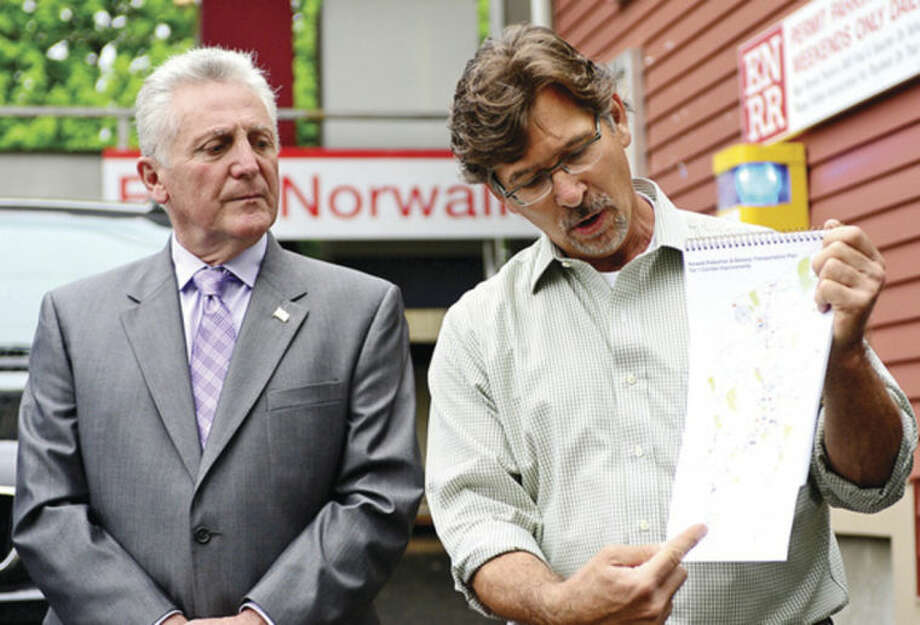 "Hour photo / Erik Trautmann Mayor Harry Rilling, left, announces the formation of ""Norwalk Bike/Walk Task Force"" including Mike Mushak, right, Thursday on westbound side of East Norwalk Train Station."