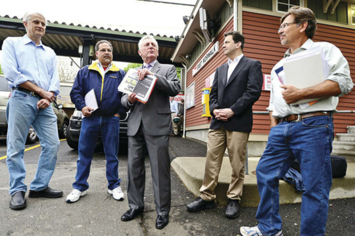 Hour photo / Erik Trautmann Mayor Harry Rilling, center, announces the formation of