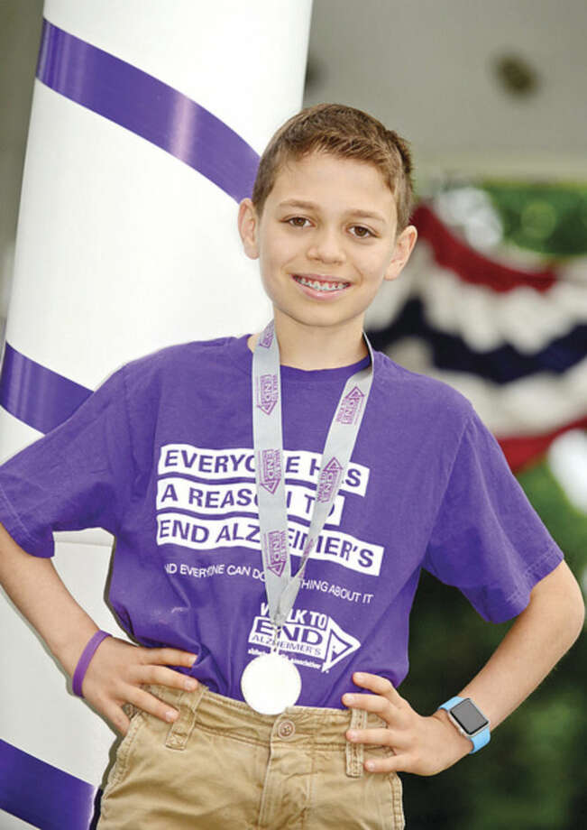 Hour photo / Erik Trautmann 12-year-old Max Rosenberg is leading the Memory Makers team in the Connecticut Chapter of the Alzheimer's Association fundraising efforts this year in honor of his grandmother who suffers from the disease. The fundraising will culminate in a walk at Norwalk's Calf Pasture Beach on October 4th.
