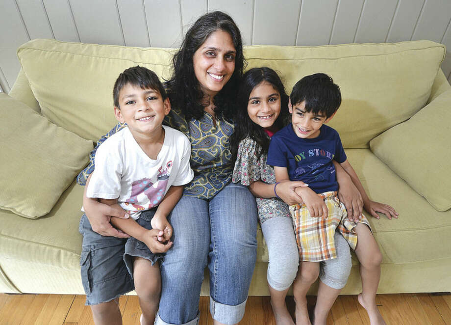 Hour Photo/Alex von Kleydorff l Mom Azra Asaduddin, with her childern 5.5 yr old Nabeel Kahn, 8yr old Nuha Kahn and 3yr old Nasif Kahn