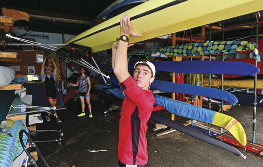 Hour photo/Erik TrautmannMartime Rowing athlete Brandon Golino gets ready for a morning training on the Norwalk River at the rowing facility on Goldstein Place.