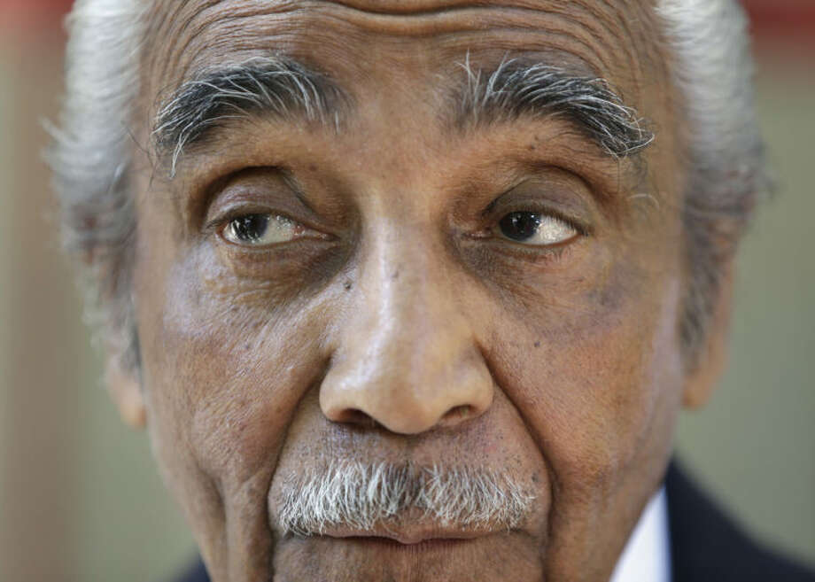 Rep. Charles Rangel, D-N.Y. speaks to reporters in New York. Voters head to the polls in seven states Tuesday, and two of the longest serving members of Congress face challenges that could end their careers. In New York, Rangel wants a 23rd term. He's still stung by a 2010 ethics scandal, and the high-profile black lawmaker also faces demographic shifts in an increasingly Hispanic district. (AP Photo/Seth Wenig)