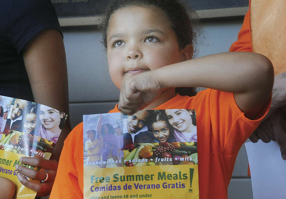 Hour photo/Matthew VinciLiliana Jayne, 8, stands with families and members of End Hunger Connecticut! Monday at Norwalk City Hall as the group kicks off the summer food service program.