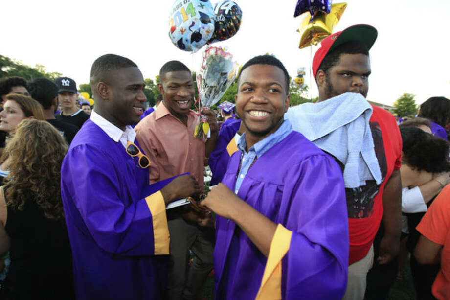 Hour Photo/Chris Palermo. Daiquan Jordan celebrates with friends and after the Westhill High School class of 2014 commencement ceremonies Thursday evening.