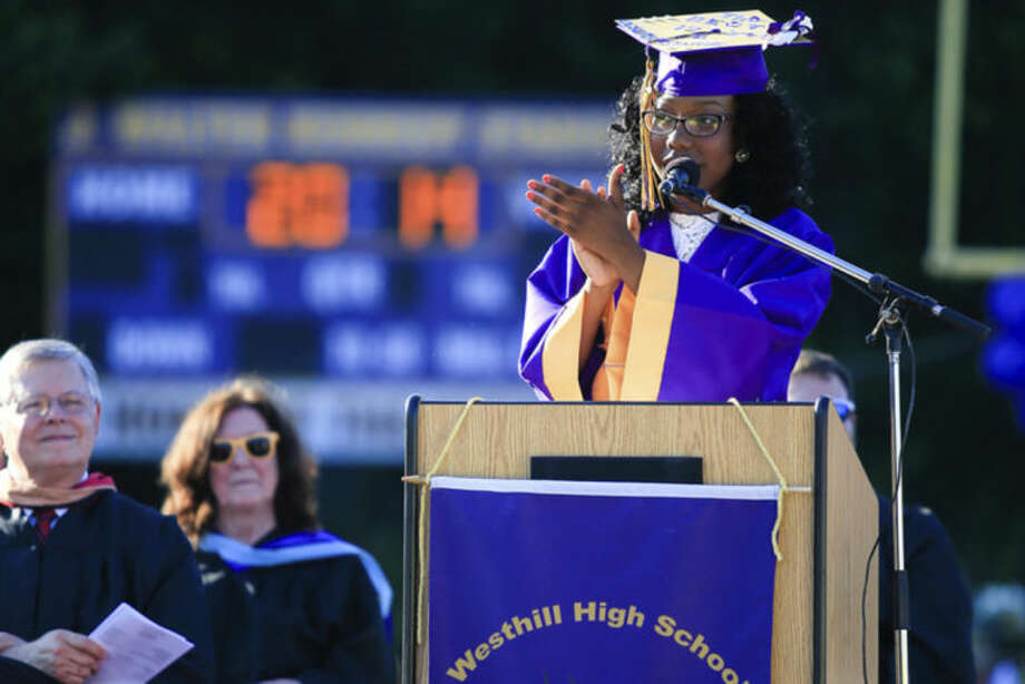 Hour Photo/Chris Palermo. Senior Class Officer Christina Peltrop adresses the graduating class during the Westhill High School class of 2014 commencement ceremonies Thursday evening.