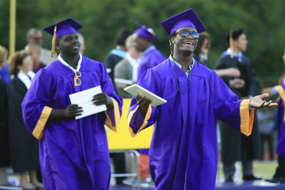 Hour Photo/Chris Palermo. Graduating students celebrate recieving their diploma during the Westhill High School class of 2014 commencement ceremonies Thursday evening. during the Westhill High School class of 2014 commencement ceremonies Thursday evening.
