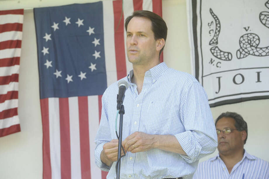 Hour photo/Matthew VinciU.S. Rep. Jim Himes, D-4, speaks Sunday at the Ice Cream Social at Lockwood-Mathews Mansion, where the Flag Day ceremony took center stage in the afternoon.