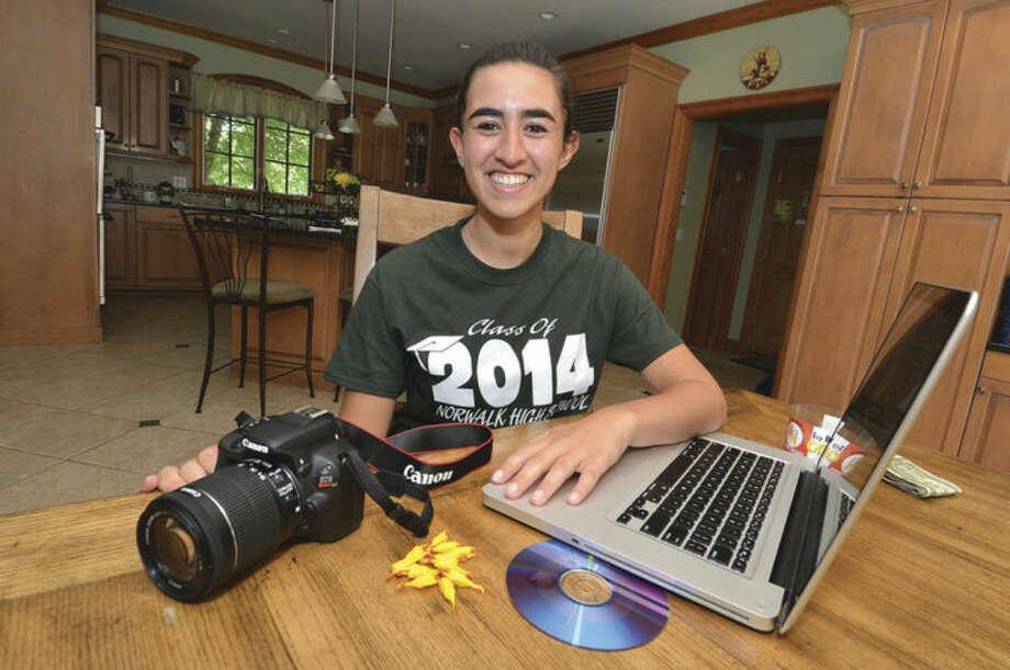 Hour photo/Alex von KleydorffNorwalk High School Class of 2014 graduate and field hockey player Toni-ann Mattera poses with her movie production equipment in her Norwalk home.