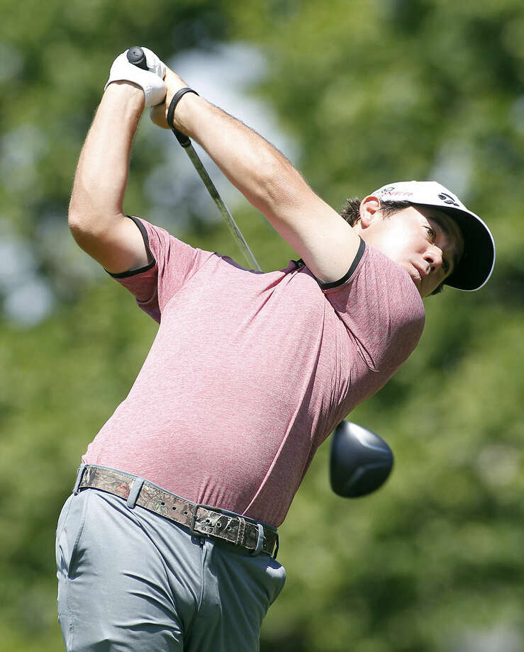 Brian Harman hits his tee shot on the sixth hole during the second round of the Travelers Championship golf tournament, Friday, June 26, 2015, in Cromwell, Conn. (AP Photo/Stew Milne)