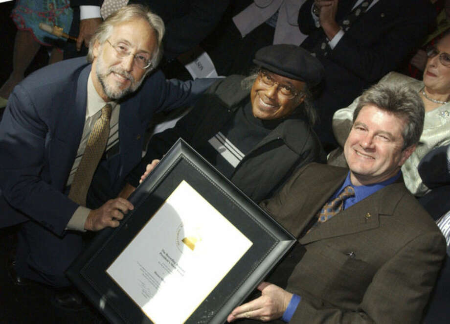This Feb. 8, 2005 photo provided by courtesy of The Recording Academy shows, Neil Portnow, left, president of the Recording Academy, Horace Silver, center, and Dan Carlin, chairman of The Recording Academy, during the GRAMMY Salute to Jazz in Los Angeles. Silver, a pianist, composer and band leader with a tireless inventiveness who influenced generations of jazzmen with his distinctive hard bop sound, died Wednesday, June 18, 2014. He was 85. (AP Photo/Courtesy The Recording Academy)