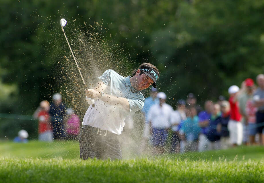 Bubba Watson hits out of a sand trap on the 13th hole during the second round of the Travelers Championship golf tournament, Friday, June 26, 2015, in Cromwell, Conn. (AP Photo/Stew Milne)