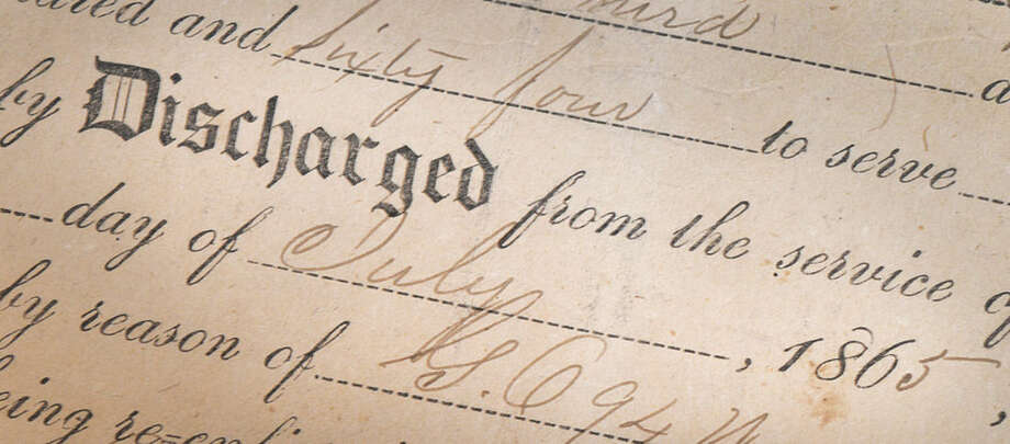 Hour Photo/Alex von KleydorffEdwin L. Tuttle's discharge papers from July of 1865 the Civil war