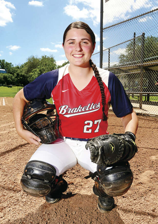 Hour photo / Erik Trautmann Former Norwalk High softball star Mary Sciglimpaglia is playing catcher for the Stratford Brakettes, one of the nation's softball powerhouses.