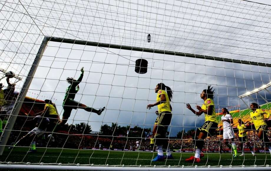 Colombia's Catalina Perez (22) leaps to make the save against United States during first half FIFA Women's World Cup action in Edmonton, Alberta, Canada, Monday, June 22, 2015. (Jason Franson/The Canadian Press via AP) MANDATORY CREDIT