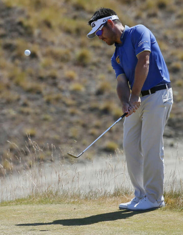 Louis Oosthuizen, of South Africa, hits a chip on the third hole during the final round of the U.S. Open golf tournament at Chambers Bay on Sunday, June 21, 2015 in University Place, Wash. (AP Photo/Matt York)